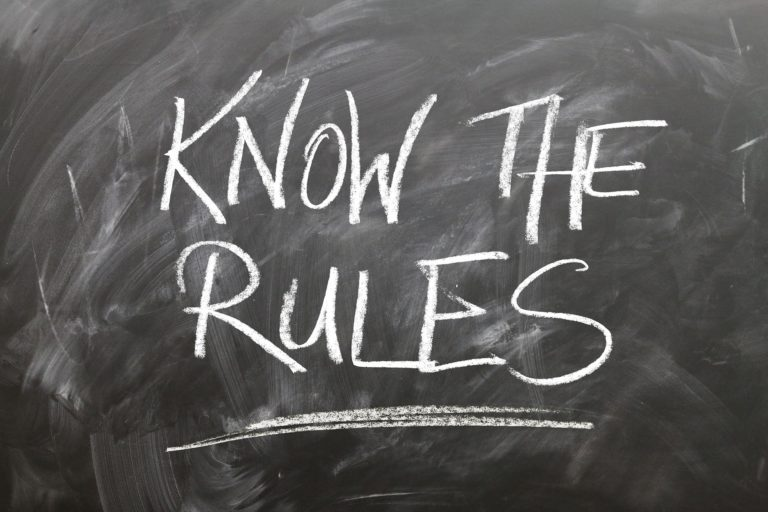 Chalkboard with the words 'Know the Rules' written on it